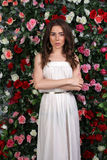 Girl in white dress on floral background Royalty Free Stock Image