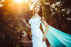Girl in white dress in forest. Beautiful girl in the woods in a white dress with headscarf Royalty Free Stock Photos