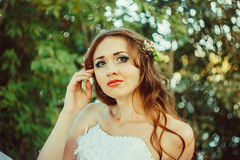 Girl in white dress in forest. Beautiful girl in the woods in a white dress with headscarf Royalty Free Stock Photo