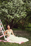 Girl in white dress in the garden in spring Royalty Free Stock Photography