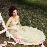Girl in white dress in the garden in spring Stock Image