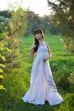 Girl in a white dress on a glade Royalty Free Stock Photography