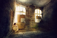 Girl in white dress in grunge interior Royalty Free Stock Photos