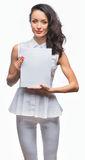 Girl in a white dress holding plate. The girl in a white dress holding a white plate in hand on an isolated background stock photos