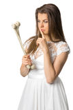 Girl in a white dress holding a rib of a man royalty free stock images