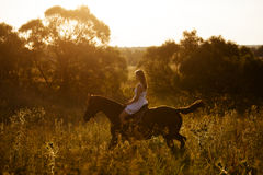 Girl in white dress on a horse Royalty Free Stock Photo