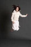 The girl in white dress jumping Royalty Free Stock Images