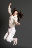 The girl in white dress jumping Stock Image