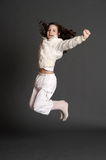 The girl in white dress jumping Stock Photography