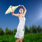Girl in white dress with kerchief Royalty Free Stock Photo