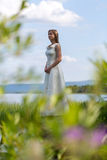 Girl in white dress on the lake Stock Photo