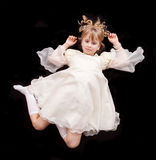 Girl in white dress laying on floor Stock Photography