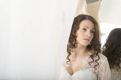 Girl in a white dress at the mirror. Stock Image