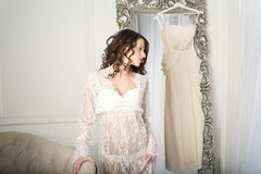 Girl in a white dress at the mirror. Stock Photo