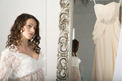 Girl in a white dress at the mirror. Royalty Free Stock Photography