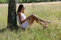 Girl in white dress near birch. Photo 2 royalty free stock photos