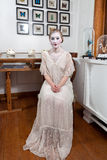 Girl in white dress and old make-up Royalty Free Stock Images