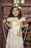 Girl in white dress with pearl beads Stock Image