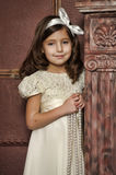 Girl in white dress with pearl beads Stock Photos