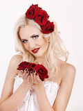 Girl in a white dress with roses. In her hair Royalty Free Stock Photography