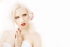 Girl in a white dress with roses. In her hair Royalty Free Stock Photos