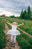 Child runs and jumps on a path in the field Stock Photography