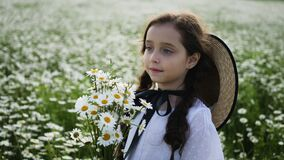 Girl in a white dress of seven years with big eyes