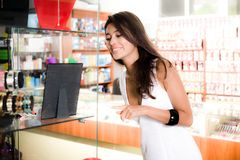 Girl in white dress is shopping Royalty Free Stock Images