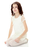 Girl in white dress sits on my knees. Royalty Free Stock Photo