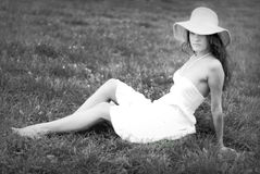 Girl in white dress sitting Royalty Free Stock Photos