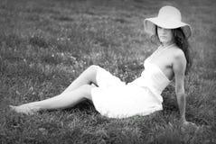 Girl in white dress sitting Royalty Free Stock Photos