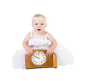 Girl in white dress sitting near the old clock Royalty Free Stock Photos