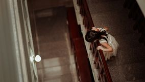 Girl in White Dress Standing in Front of Railings Stock Photo