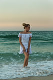 Girl in a white dress standing in the water Royalty Free Stock Images