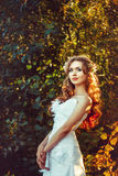 Girl in a white dress at sunset. Bride in white dress standing in the sunset Royalty Free Stock Photos