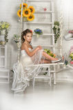 Girl in white dress on a swing Royalty Free Stock Photos
