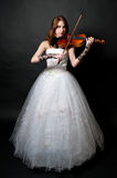 Girl in white dress with violin Royalty Free Stock Images