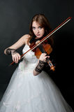 Girl in white dress with violin Stock Photos