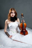 Girl in white dress with violin Royalty Free Stock Photography
