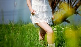 Girl in white dress walking Stock Photography