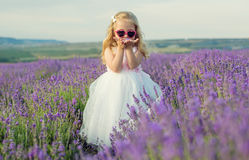 Girl in white dress walking in lavender Royalty Free Stock Images