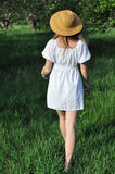 Girl in white dress, walking in the old garden Royalty Free Stock Images