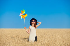 Girl in white dress and wind toy Royalty Free Stock Photography