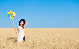 Girl in white dress and wind toy Stock Photo