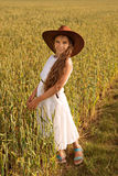 A girl at the wheat field in a cowboy hat stock photography