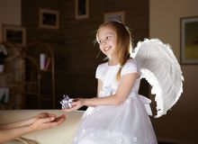 Girl in white dressed as an angel Stock Photography