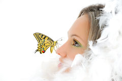 Girl with white feathers and butterfly stock photo