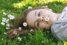 Girl with white flowers Stock Photography