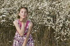 Girl with white flowers throwing kiss Stock Photography