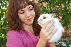 Girl with a white fluffy rabbit Stock Image